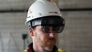 construction worker with VisualLive AR HoloLens 2 glasses flipped down