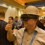 participant at Autodesk university giving a thumbs-up while wearing the VisuaLive HoloLens 2 AR system