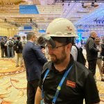 participant at Autodesk university walking arround wearing the VisuaLive HoloLens 2 AR system
