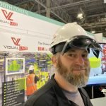 VDC attendee at Autodesk university wearing VisualLive hardhat with HoloLens 2