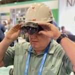 VDC wearing at Autodesk university VisualLive HoloLens 2 hard hat